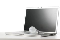 Laptop and bulb Stock Photography