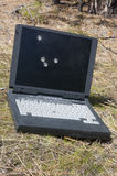Laptop with bullet holes Stock Photography