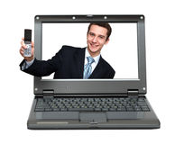 Laptop with businessman giving your phone stock photography