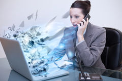 Laptop of a businesswoman exploding Royalty Free Stock Photo