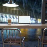 Laptop on cafe table Stock Image