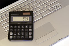 Laptop and Calculator. Silver Laptop and black Calculator Royalty Free Stock Photography