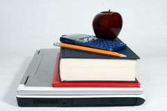 Laptop, calculator, books, apple and pencil Stock Photos
