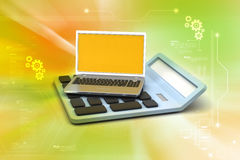Laptop with calculator Royalty Free Stock Image