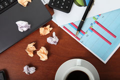 Laptop, calculator, cup of coffee and crumpled paper Royalty Free Stock Photo