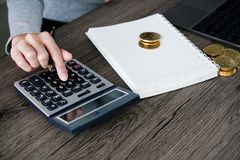 Laptop with calculator and golden bitcoin. Cryptocurrency invest Stock Images