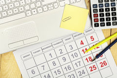 Laptop and calendar Royalty Free Stock Photography