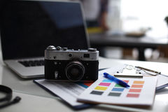 Laptop and camera on the desk with folder Royalty Free Stock Images