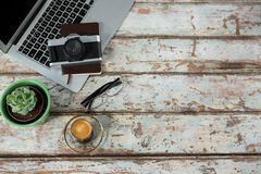 Laptop, camera and diary with coffee cup Stock Photos