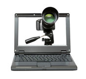 Laptop with camera on tripod Royalty Free Stock Image