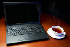 Laptop and a cap of tea Royalty Free Stock Image