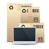Laptop with Cardboard Boxes Stock Photos