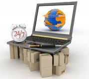 Laptop on cardboard boxes wiht clock and pen Royalty Free Stock Photo
