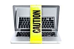 Laptop with caution tape around it Stock Images