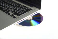 Laptop and CD Royalty Free Stock Images