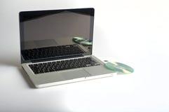 Laptop and CD Stock Photos