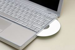laptop cd fotografia stock