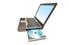 Laptop and cd-drive isolated. On the white Stock Photos