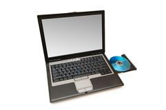 Laptop and cd-drive isolated. On the white Stock Photography