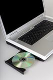 Laptop and Cd-rom. Silver laptop computer with CD tray opened Stock Images
