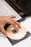 Laptop with CD in the tray Royalty Free Stock Image