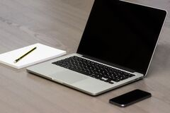 Laptop and cellphone Stock Photography