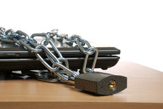 Laptop in the chain Royalty Free Stock Photos