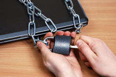 Laptop in the chain Stock Photo