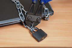 Laptop in the chain Royalty Free Stock Photo