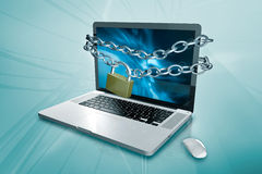 A laptop with a chain and padlock Stock Image