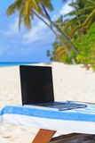Laptop on chair in beach vacation Royalty Free Stock Photography