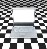 Laptop On Checker Board. Background Stock Photo