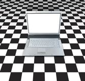 Laptop On Checker Board. Laptop Computer On Checker Board Background Royalty Free Stock Photos