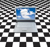 Laptop On Checker Board. Background royalty free stock photos