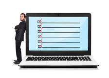 Laptop with checklist Stock Images