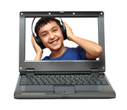 Laptop with child listening music Royalty Free Stock Image
