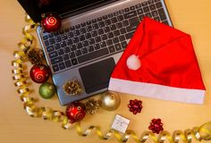Laptop and christmas decorations stock photos