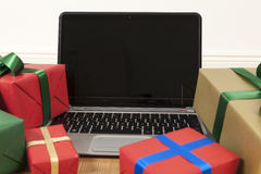Laptop and christmas presents Stock Photos