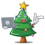 With laptop Christmas tree character cartoon. Vector illustration Royalty Free Stock Images
