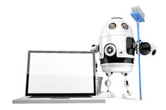 Laptop cleaning concept. Robot cleaning laptop with a mop. Isola Royalty Free Stock Photos