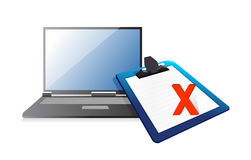 Laptop and clipboard with xmark Royalty Free Stock Photo