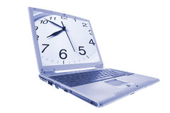 Laptop with Clock on Monitor. In Blue Tone royalty free stock photo