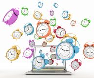 Laptop and clock, taking off from his screen Royalty Free Stock Images