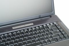 Laptop Close Up. A partial shot of a laptop computer. Part of the screen and part of the keyboard are shown. The rest is a white background royalty free stock photos