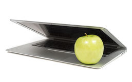 Laptop Closing on an Apple Stock Photo
