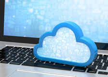 Laptop with cloud computing symbol on keyboard Royalty Free Stock Photos