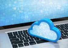 Laptop with cloud computing symbol on keyboard Royalty Free Stock Photo