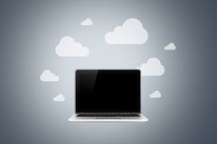 Laptop and Cloud Technology Stock Image