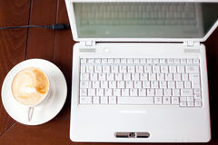 Laptop and coffee Royalty Free Stock Photo