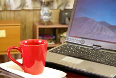 Laptop and Coffee Stock Photography